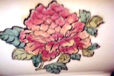 Flower on outside of bowl