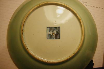 I have a plate that I think is Chinese. It is 25cm wide and 3.5cm high. It is green with a \ gold\  boarder and covered with small birds butterflies and ... & Chinese Plate? with unknown markings