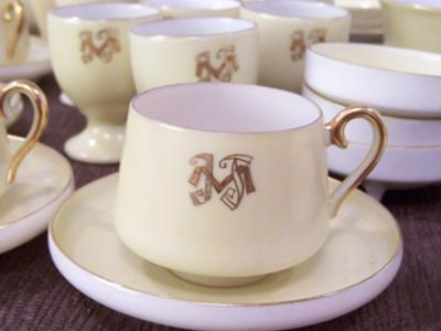 Small cup and saucer with monogram
